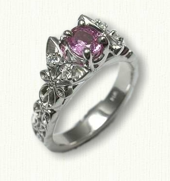 14kt White Gold Butterfly Love Knot engagement ring set with an eye clean .50ct Oval Pink Sapphire and side diamonds