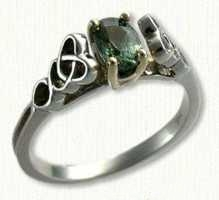 14KY Celtic Pierced Dara Ring with oval Green Sapphire