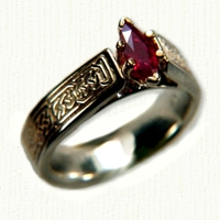 14kt yellog gold Bridget Engagement Ring with Pretzel Knot pattern and marquise cut ruby
