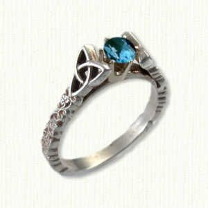 Tressa #1: 14kt white gold set with an oval blue gemstone