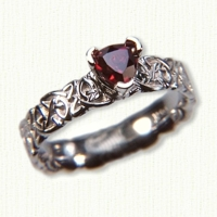 14kt white gold 'Cara' style ring with sculpted triangle knot pattern & trillion ruby
