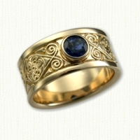 14kt yellow gold Celtic Triskele Knot Wedding Band set with a bezel set round blue sapphire